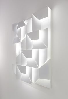 Charles Kalpakian: This project is a cross between art and design and has arisen from Kalpakian's continuous exploration of the three-dimensionality of surfaces. Its graphic composition becomes a texture lit up by the LED bulbs placed inside the various elements, creating a canvas of shadows.