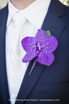 White tie on a white shirt with a purple vanda orchids for the boutonniere. Mimosa Flower Studio. For the Alpha Lounge at Brides Rock a Southern Brunch and Brides Rock a dream Wedding. www.bridesrockbridalexpos.com
