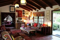 Vintage Style Bohemian Living Room -  this reminds me SO MUCH of my grandmother's house, even down to the wood beam ceiling and everything. She was an artist and loved beautiful things. She was a traveller and collected things from everywhere that she went; later in life she mostly loved the Southwest, Sedona Arizona in particular and her purchases as well as her home definitely reflected that