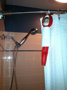 Elf on the Shelf Hides In Shower  My son couldn't find our Elf anywhere, then he went to take a shower and found him hanging in the bathroom after his shower. He thought it was hillarious!  I wrapped a paper towel around him to look like our white towels.