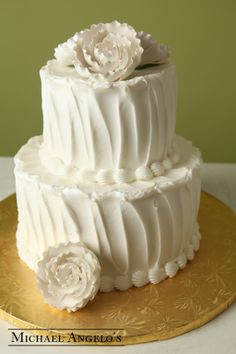 White Stucco #60Modern  This cake is perfect for a smaller sized wedding or even a bridal shower. The stucco look is very popular. Colored icing can be added to match your wedding.