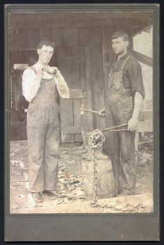 cabinet card from the 1890s featuring two blacksmiths in overalls. The blacksmith on the left is wear overalls with great pocket details. Bo...