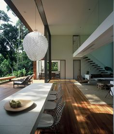 Double volume sliding doors open up  to form a seamless blend between indoor and outdoor spaces.