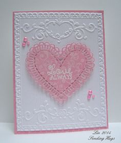 habndmade Valentine ... SSS Jan 15 Emboss It by quilterlin ... pink and white ... luv the look of the heart die cut from patterned paper ... beautiful textures from embossing folders ... delightful card!