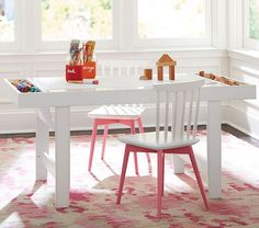 No pink chairs. The playroom should match the theme of the house. The table is great.