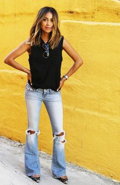 Black tank and distressed flare jeans