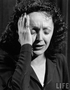 edith piaf. What a voice!  What a life!  She rips my emotions and I don't even speak French!  That's the power of music especially under the control of a Piaf!