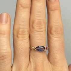 This one of a kind ring sold a while ago but it was my favorite from the group in came in with so I wanted to share it anyway. 1.02 carat blue and white bicolor sapphire with a lemon yellow sapphire, peach pink trillion cut sapphire and old European cut white diamond. If you're interested in creating something similar contact mociun@mociun.com #mociun #mociunjewelry #mociunoneofakind #sapphires #diamonds
