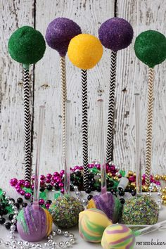 I've got another fun Mardi Gras treat for you today.Some fun Cake Pops that are filled with the Green, Gold, and Purple colors of a festive Mardi Gras party!Don't you just love them?Did you notice anything different in the photo?? I've gott...