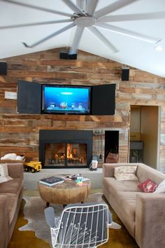Tracey MacKenzie: Up-cycled wood wall with hidden television