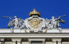 Architectural artistic decorations on Hofburg palace, Vienna; Hofburg was residence of Habsburg dynasty, rulers of Austro-Hungarian Empire. Vienna, Austria on October Austro Hungarian, October 10, Vienna Austria, Greek Mythology, Architecture Details, Statue Of Liberty, Palace, Empire, Lion Sculpture