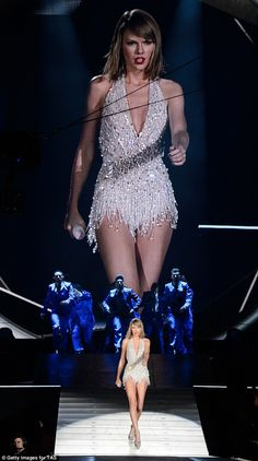 Strut it: The singer put on a sassy display as she strut her stuff down the 'runway'...