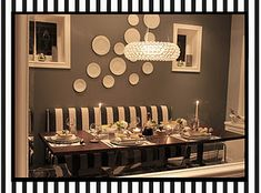 DYI decorate your dining room with plates. A great idea on a small budget. Love it!
