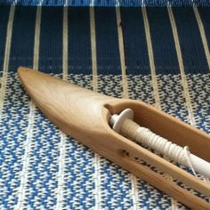 On the loom with a cotton table runner. 4 shaft very simple pattern. One of my favorites so far.