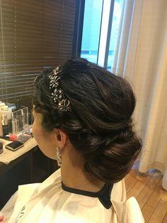 Wedding hair braided bun with Vera wang head dress