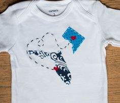 Washington DC and Florida onesie   She puts any states on shirts and puts hearts on the cities of yiyr choice. Hand stitched!  https://www.etsy.com/listing/219025013/state-to-state-with-love-shirt-or-onesie