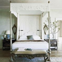 beautiful bedroom with stunning four poster bed and carved headboard by Michael S Smith