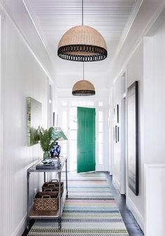 The hallway of this classic Queensland weatherboard home is in line with the rest of the home. Photo: Maree Homer | Styling: Kate Nixon | Story: Australian House & Garden