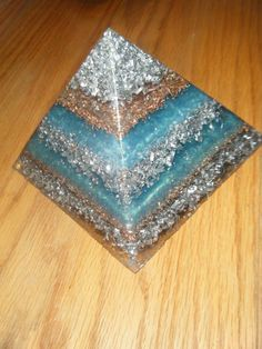 Orgonite Pyramid (Mine)  *ABOUT ORGONITE* -Simple. Easy to make. Works continuously. -Turns negative energy into positive energy. -Purifies the atmosphere, detoxifies water, ends drought. -Helps plants grow better, repel pests & require less water. -Mitigates harmful effects of EMF radiation. -Disarms and repels predatory forms of life. -Inspires a pleasant demeanor and balanced, happier moods. -Frequently remedies insomnia and chronic nightmares. -Helps awaken your innate psychic senses.