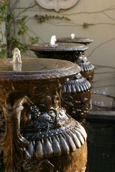 beautiiful urns as a water feature