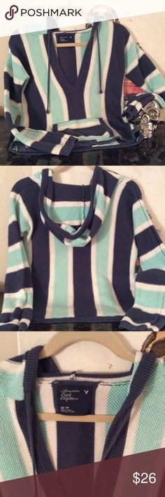 American Eagle sweater American Eagle hooded pull over sweater. So adorable! The sweater version of a baja jacket. Navy, Aqua and white stripes. NWOT💙💙💙 American Eagle Outfitters Sweaters Shrugs & Ponchos