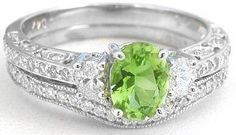 Peridot Engagement Rings__MJS Comment: We've taken an elegant vintage inspired engagement set and given it a whole new, colorful style with a gorgeous and bright peridot. We loved this set so much that we made it in almost every gemstone.
