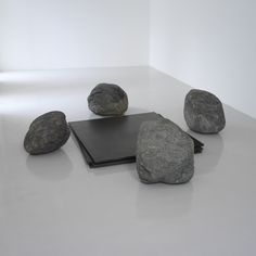 LEE UFAN Relatum - Discussion, 2003 Four iron plates and four stones Stones: 50 x 60 cm each (approx)  Iron: 140 x 130 cm each  When in installed: 305 x 305 x 61cm