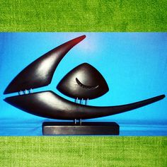 Fish statuemade with wood by GalleriaCentral on Etsy, $65.00