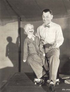 "Lon Chaney as 'Echo' the ventriloquist with his little friend: ""The Unholy Three,"" 1930."