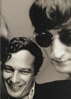 """John Lennon with The Beatles Manager: Brian Epstein, who """"discovered the Beatles"""", I think at """"The Cavern"""". He got them a record deal, eventually ___ made 'em wear suits instead of Biker 1950s Leather. He helped them become STARS, and without Brian Epstein -- there wouldn't be all those albums! Photo by Whitaker"""