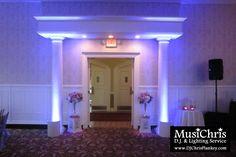 Lilac wedding lighting. Light purple uplighting flanks the grand entrance to the Sloane Ballroom at Cranwell Resort in Lenox, MA.