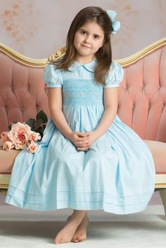 Our sweet Madison has style and grace with heart patterned hand smocked bodice and rosebud embroidery on the bodice and collar.  Piping on the...