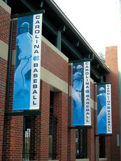 Using Ferrari Vision Mesh and a Durst printer with UV-based Durst inks, Rainier designed and produced banners (in Tar Heels blue) with frames that mounted between existing brick columns. Pole Banners, Flag Banners, Outdoor Signage, Outdoor Banners, Signage Design, Cafe Design, Ui Design, Museum Jobs, Pole Sign