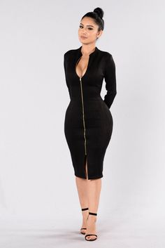 - Available in Black and Burgundy - Suede Fitted Dress - Midi Length - Long Sleeve - Front Slit - Mock Collar - Functional Zipper - Made in USA - 95% Polyester 5% Spandex