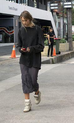 Oversized black sweater / dark grey dress / white Isabel Marant Bekett sneakers / black leather backpack
