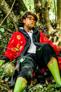 Taken by Dark Star Photography (https://www.facebook.com/DarkStarPhoto). From a cosplay photoshoot on Dartmoor. The subject was a female design of the Other Father from Henry Selick/Neil Gaiman's Coraline, however with the pumpkin twist from the end of the movie. Placed somewhere in between his first moment of degrading and close to his last. Face makeup was by the Blue Girl (https://www.facebook.com/TheBlueGirl). https://www.facebook.com/otherbuttonscosplay
