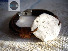 """Reef - White roller shell - Surfstyle bracelet – Jewelry Unisex – Italian brown leather, dark brown braided leather and pewter clasp - Length of 7 1/4"""" (18.5 cm) - 95.00$ - See this unique piece on seaucollection.com"""