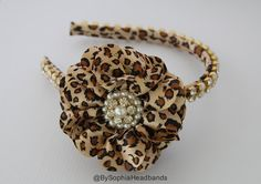 *** LEOPARD FLOWER HEADBAND***    - Unique Handcraft Flower with a beautiful high quality Pearl and Rhinestone Center placed on Headband. The Band