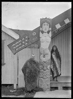 Exterior view of Wairaka Meeting House, Whakatane, showing the marakihau (mermaid) carving on the left amo