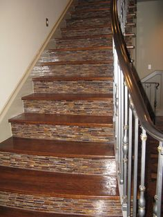 Fabulous staircase with tile up the risers.