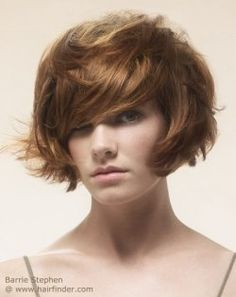 Very short bob with layers and a lot of volume. Light brown hair.