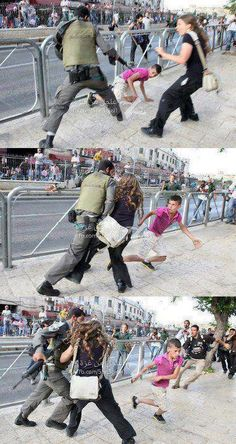 An Israeli woman protects a Palestinian boy from an Israeli soldier.