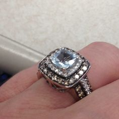 Love that this is non-traditional and not a diamond.  I believe it is an aquamarine!