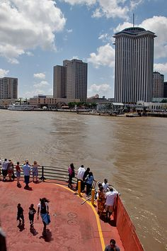 From the Algiers ferry--there was one of those round, rotating restaurants atop the tallest building in this photo.  We went there years ago...wonder if it's still there.  slj