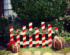 Candy Cane Picket Fence This fence will look great simply holding your favorite Christmas stockings, on the porch or even serving as a backdrop for your family photos! You have the option to receive t Outside Christmas Decorations, Christmas Wood Crafts, Decorating With Christmas Lights, Grinch Christmas, Christmas Porch, Christmas Projects, Simple Christmas, Christmas Stockings, Outdoor Candy Cane Decorations