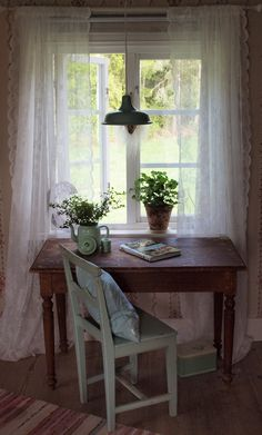 .A writing table next to a window looking out onto a garden - perfect. I keep my sewing machine here