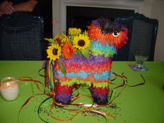 Remember I had mentioned this idea?! Getting a pinata and cutting a big hole in it and filling it with flowers as decor for the rehersal dinner... can't believe I found a pic of it :)