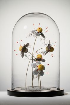 "In her ongoing sculptural series titled ""The Marriage,"" Malaysian artist Noreen Loh Hui Miun merges elements from real and fictional plantlife to create entirely new species. The fragile works begin with dried plant components like branches and moss to which she adds cut laminate petals reminiscent"