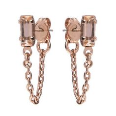 An elegant and understated twist on our best-selling baguette earring, this lovely earrings features a petite length of chain that extends from the front to back of ear. A gorgeous addition to our cla