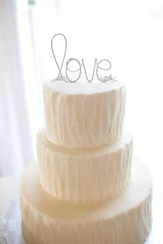 Wire love wedding cake topper.